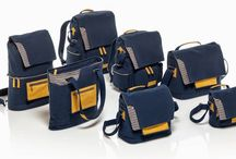 Mediterranean Bags / The Mediterranean collection is inspired by the sea and travel. The deep blue canvas is parallel to the deep blue colour of the Mediterranean Sea. The blue and white stripes further add to the nautical theme. Ochre leather trim adds a touch of freshness and personality, enriching the style of each bag.