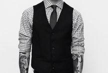 tattooed men shot suit up