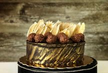 Callebaut chocolate cakes / #brushstrokemania. Dark moist chocolate cake filled with hazelnut mousse and LINDT chocolates frosted with 70%dark Callebaut ganache and topped with white chocolate brushstrokes and Ferrero Rochers