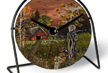 My Oil paintings on recycled DVD's, saws and skillets  / Original oil paintings on recycled CD's.  I attach them to a wire stand and can make them into a desk clock.