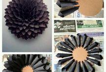 Construction paper flower / Rolls of construction paper on flat circle construction paper