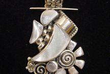 Exquisite Jewelry / Lanning Gallery carries three truly gifted jewelry artists: Master Jeweler Michael Grant, Internationally award-winning jewelry artist Valerie Ostenak and Peruvian (now US) jewelry artist Victor Yurivilca.
