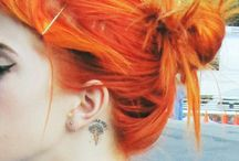 phase 2; vibrant orange hair. plateau sandals.