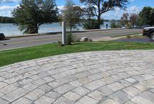 Reclaimed Granite Used in Patios/Walkways / Using reclaimed granite curbing, cobblestones and split pavers from our inventory, we designed and built a patio/walkway including historic granite radius benches as well as native plant materials.
