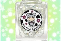Yeti-Moo / Adorable holo topper with snowy glitters such as white daisies, white stars, small white dots, white squares, white hexes in various sizes, iridescent glitters and tiny color-shifting iridescent glitters.  It is designed to be layered over different colors.
