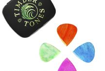 JAZZY TONES / Jazzy Tones are designed for those Guitar Players who need the speed and accuracy of a Jazz III Guitar Pick but also want a bit more 'Bling'. They are made from Vietnamese Water Buffalo Bone and then pressure dyed with a permanent colour.