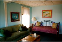 "Efficiency Suite - The Old Village Inn / The Efficiency Suite is located off a private entrance on second level of our establishment and is considered a ""two-room"" suite.   Bedroom w/Queen Bed Living Room Large Balcony with Ocean View Day Bed in Living Room Kitchen"