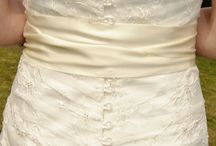 Wedding Dress for Sale / My Wedding dress - Essence Wedding Dress. Size 8. Sweetheart neckline, Asymmetrical pleated beautiful lace design with hand-stitched beading and button down back. Tea length (above ankle).