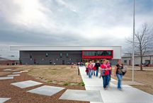 Green Forest Middle School / This new two-story middle school is located in the small agricultural community of Green Forest, Arkansas, in a wide valley among the Ozark Mountains. During the initial evaluation of the proposed site, we recognized the importance of the existing central green space as a common area for the campus. Used throughout the day as a gathering place for middle school and high school students, it is a transitional space consistently traversed by all manner of students and members of the community.