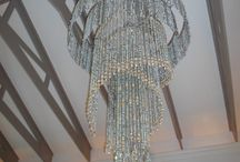 Chandeliers / The materials used in our product designs are recycled plastics, wooden beads, glass and chain as well as shells; our aim is to always find new designs and material to work with.
