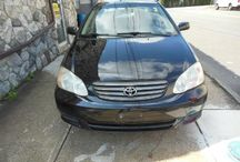 Used 2003 Toyota Corolla for Sale ($4,700) at Paterson, NJ /  Make:  Toyota, Model:  Corolla, Year:  2003, Body Style:  Tractor, Exterior Color: Black, Vehicle Condition: Excellent, Mileage:135,000 mi,  Engine: 4Cylinder L4, 1.8L; EFI, Transmission: Automatic, Fuel: Gasoline Hybrid.   Contact:973-925-5626   Car Id (56679)