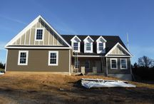 Hardie Timberbark Lap and Board & Batten Monterey Taupe   Foristell, MO. (63348) / This is a siding project that features James Hardie Lap Siding in Timberbark & James Hardie Board & Batten Monterey Taupe. It is located in Foristell, Missouri.