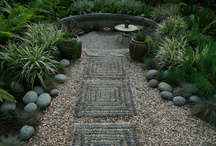 garden pebble mosaics / by Kathy Lynch