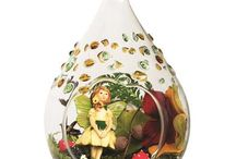 Solar Glass Fairy House / Create a welcoming home for wee fairy folk in this gorgeous hollow glass teardrop, sparkling with jewel bits of hand-adorned green and gold glass. Your hand-designed fairy garden lights up at dusk, bathing your miniature magical scene in light, all solar powered. http://www.allsopgarden.com/solar-glass/solar-glass-fairy-house/model-31058/solar-glass-fairy-house/