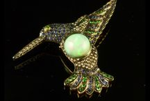Antique Brooches / A stunning collection of Antique Brooches, from the Edwardian, Georgian, Victorian and Art Deco periods up to the present day, encrusted with Diamonds, Sapphires, Emeralds, Rubies and Semi Precious stones.