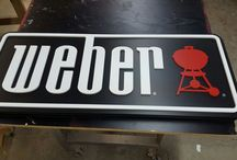 Weber BBQ's / Weber grills have become synonymous with backyard BBQing. Whether you're looking for a portable camping grill, or behemoth backyard beauty BBQ, Weber has a product for you. We at DNS were tasked with creating the branding signage for Weber's. As well, we installed a display in a local Jacuzzi dealership, for a cross-brand promotion.