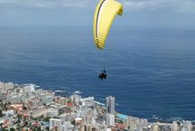 Paragliding - Cape Town  / What better way to capture some unforgettable memories than to experience the magic of tandem paragliding in Cape Town? For the longest time, it has been man's ambition to fly in the sky and experience the exhilaration of being semi-weightless and to explore landscapes from high in the sky. Paragliding in Cape Town will allow you to fulfil these ambitions and experience all the spectacular wonders of the Cape from a birds eye view.