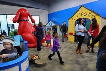 "Kidzu Children's Museum, Chapel Hill / Kidzu #Children's #Museum has opened its new ""Launch Pad Location"" in #Chapel Hill's University Mall. Now through May 26th, 2014, Kidzu is hosting the highly acclaimed traveling exhibit from the Minnesota Children's Museum, Adventures with Clifford The Big Red Dog. Visitors and residents are encouraged to pay a visit. http://bit.ly/1bERcsJ"