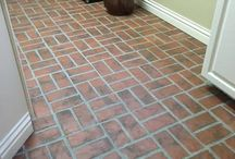 Brick Tile Bathrooms / Brick tiles can be used on bathroom floors, even extending into the shower. Customers have also used them on shower walls. Seal with a good penetrating sealer, and water will just roll off.