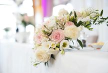 Wedding Flowers on Tables and Pedestals / Flowers brighten and decorate any wedding day or occasion