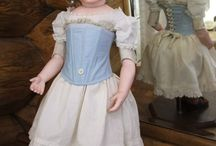 Repro doll costumes