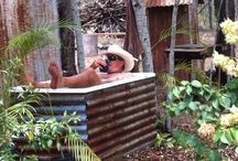 Outdoor tub / Second hand fibre glass bath tub, supported by steel frame and sheeted with rusty corrogated irion