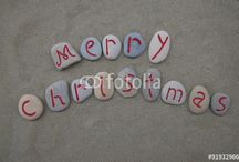 HAPPY CHRISTMAS / Happy Christmas on stones in different languages