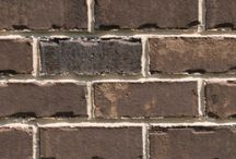 Fort Mill   Triangle Brick Company   / Our village-inspired Fort Mill brick, offered in a earthy, burnt umber color with sepia and subtle cream accents, looks just as at home in a suburban neighborhood as it does on a city block. This tumbled brick is classified under our Select tier, providing our residential and commercial customers with an exterior cladding option that's superior in every way.