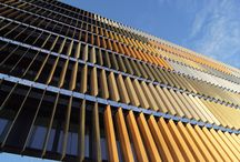 Glass facades/walls / Glass facades of laminated glass with SEFAR Architecture VISION fabrics