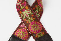 Colorful Camera Straps / Camera straps that feature bright colors and designs.  All straps have padded neckline, leather piping, suede backing, and a compact flash card pocket built in.  Straps have a heavy duty quick release buckle to make them easy to switch out to match clothing and other fashion accessories.