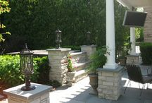 """Oak Brook Sanctuary / """"This backyard paradise is the entertainer's dream.  The expansive patio area includes a built-in BBQ, custom pergola with a TV, hot tub, fire pit and pondless waterfall.  Steps and piers were built to hide the hot tub from view.  All walls, steps and piers were constructed with mortared limestone with bluestone caps.  The patio is dry-laid bluestone."""""""