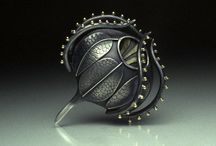 Silver brooches