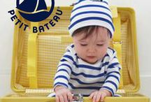 """Petit Bateau / A young, spontaneous brand steeped in the magic of childhood. The company demonstrated its decidedly playful spirit right from the start with a cut-off pair of """"long johns"""" which they coined the """"petite culotte""""! Over the past 120 years of weaving at its factory in Troyes, France, Petit Bateau has carefully perfected its unique style featuring the highest quality clothing that is always ultra comfortable and fun to wear."""