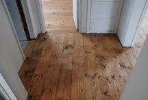 Wooden floor and walls.