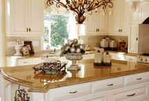 The Gold Southern Kitchen  / Great double island kitchen, with a bertazzoni range and paneled appliances. Designed by Southern Kitchens, Inc.
