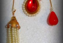 hand made jhumka / these jhmki /earrings are made up of paper . this art is known as quelling.