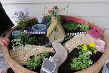 Wine Barrel Fairy Garden / This Fairy Garden in a Wine Barrel was created for a client as a birth present.  It's amazing don't you think?  So many little areas for the birthday girl and her sister to explore.    If you want to create your own, I have most things in stock in my store.  www.fairydoorsandmore.com.au