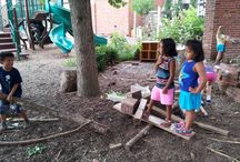 """Messy Materials / An area covered with wood chips or mulch where children can dig, carry heavy objects such as sections of tree stumps, and explore other """"messy"""" materials supports children's visual/spatial skills as well as body competence."""