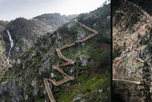 PAIVA WALKWAYS / Arouca, Portugal Paiva Walkways embraces the Paiva river with an extension of 8km, providing a walking path with a breathtaking natural beauty, with picturesque landscapes, waterfalls and a variety of fauna and flora species. This is an unusual experience marked by winding stairs to the top of the hill with stunning sceneries, and a very narrow wooden bridge which spans across the river among cliffs and abundant vegetation.