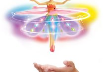 Deluxe Light Up Flutterbye Fairy - Rainbow / http://www.flutterbyeflowerfairy.com Fairies Flutterbye miracle really can fly and can be controlled as he floats on the palm of the hand, and now they can even reach the sky!