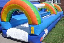 Rainbow Slip n' Slide / Atlantis Inflatables has Niagara's only 30′ Inflatable Slip n' Slide! Perfect for kids and adults of every age, and fits in most back or front yards. BEAT THE SUMMER HEAT with this great addition to any Birthday Party, End of the School Year Party, Family Reunion, Block Party, Summer BBQ and MUCH MUCH MORE! All you need to enjoy this bright and cheery watery wonderland is a water source, a bathing suit, a running start, and lots of energy!