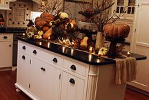 Thanksgiving Kitchens / A collection of some kitchens decorated for Fall and Thanksgiving. We're loving the look of warm brown and orange tones beside stone countertops!