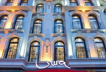 surahotels / Sura Hotel welcomes you with the latest features in comfort and style for their guest's. Sura offers 60 innovative designed rooms and suites. Our rooms are among the largest and most luxurious accomodations in Sultanahmet. There is four different stylish floors, Amber,Turquoise,Lapis, and Silver. All rooms have self control air conditioning, sound proof, fresh air recovery, Ip tv with wireless keyboard, video on demand, neatly decorated marble bathroom with rain shower, and high quality linen.
