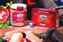 Atún Claro en Aceite de Oliva / Atún Claro una vez en fábrica, es elaborado artesanalmente y regado con aceite de oliva. Envasado en tarros de vidrio para garantizar su calidad, presentación y fino sabor.