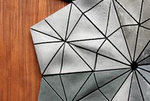 Aperiodix Wall Tile System / Aperiodix is a tiling system designed for decorative wall surfaces. The system is based on a set of three triangles that can be laid out in an aperiodic, or non-repeating, pattern which results in unique and constantly changing compositions. The Aperiodix system uses these three triangles and their mirrored shapes for a total of six unique tiles. The face of each triangular tile has a 3-dimensional undulating surface that always matches the neighboring tile, no matter which pattern is followed.