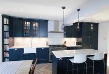 Dark Blue Schuller Kitchen / From the Schuller range at Planet Furniture, this dark blue Shaker style kitchen has crisp white Silestone Lyra worktops which provide a perfect contrast to the Indigo Blue Satin Lacquer finish. Featuring beautiful satin brass handles from Armac Martin.