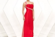 The search for THE prom dress(: / by Brittany Welch