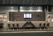 Woodify - Exhibition stands / Exhibition stands solid wood and plywood, fire retardant treated wood, Brannpanel product range. Acoustic walls using perforated plywood & stud construction to regulate and dampen sound, utilizing traditional insulation material (Glava) for absorption.