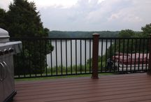 Trex Deck at Green River Lake / This is a trex transcends spiced rum deck with vintage lantern picture framing.  There are trex posts with black aluminum railings between posts.  Pathway lighting on steps.