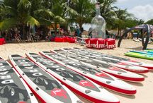 Dragon World Championships / The first ever dedicated team SUP racing event! Teams came together from across the globe to compete on the 22ft Red Dragon Inflatable stand up paddle board in Barbados for the Dragon World Championships hosted by Red Paddle Co!